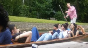 summer schools students punting in Cambridge