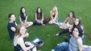 students having break in the Cambridge college grounds