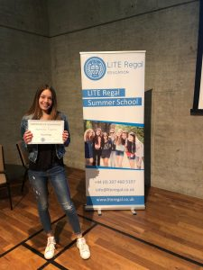 girl with certificate lite regal education