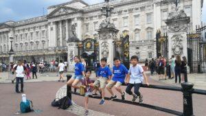 summer camp kids outside Buckingham Palace